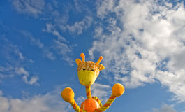 Giraffe toy over the blue sky Royalty Free Stock Photography