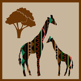 Giraffes in the African ethnic pattern Stock Photo
