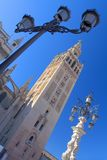 The Giralda, Seville. The Giralda in Seville, Andalusia (Southern Spain) with a traditional beautiful street lamps Royalty Free Stock Photography