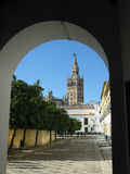 Giralda, Seville. The Giralda or Cathedral Bell Tower in Seville Spain, seen through an arch in the Real Alcazar Royalty Free Stock Photos