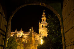 The Giralda of Seville illuminated at night, Spain Stock Photos