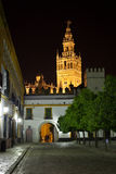 Giralda of Seville illuminated at night. Spain Royalty Free Stock Photos