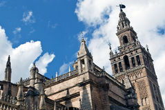 The Giralda Tower. Located in the Spanish city of Seville, built in the Almohad period and expanded over the centuries Stock Photos