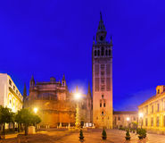 Giralda tower -  bell tower of the Seville Cathedral in evening Stock Images