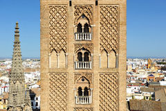 Giralda tower of the cathedral of Seville, Andalusia, Spain. Arabic architecture, detail of the Giralda tower in Seville Cathedral,  Andalusia, Spain Stock Photography