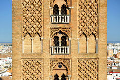 Giralda tower of the cathedral of Seville, Andalusia, Spain. Arabic architecture, detail of the Giralda tower in Seville Cathedral,  Andalusia, Spain Royalty Free Stock Photo