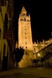 Giralda tower in Seville. The Giralda tower in Seville, Spain, illuminated at night Stock Photo