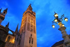 Giralda tower at sunset, Cathedral of Seville, Andalusia, Spain. Famous tower of Giralda, Islamic architecture built by the Almohads and crowned by a Renaissance royalty free stock image