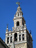 Giralda of Seville 2. Giralda is the name given to the bell tower of the Cathedral of Saint Mary of the See of Seville , Andalusia ( Spain ) . The lower two royalty free stock photos