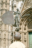 Giraldillo vane in Seville cathedral. Famous vane named Giraldillo, in facade of landmark catholic cathedral of Saint Mary of the See, public gothic monument royalty free stock image