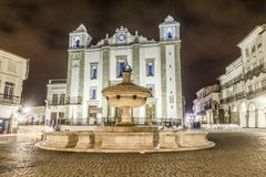 Giraldo Square with fountain and Saint Anton`s church, Evora, Al. Low-angle shot of a fountain and Saint Anton`s Church, Giraldo Square, Evora, Alentejo Royalty Free Stock Photos