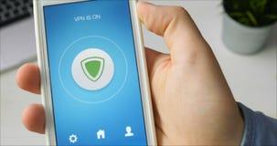 Girar el VPN en el smartphone para la navegación por Internet segura almacen de video