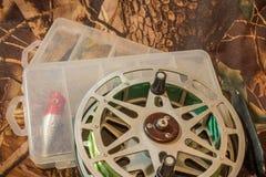 girar seduz na caixa e em pescar o carretel Imagem de Stock Royalty Free