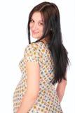Girata incinta della ragazza dietro fotografia stock
