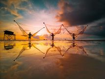 Fishermen are fishing in the East Sea, Vietnam when the sun is about to set royalty free stock photo