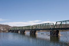 Girder bridge. Across wide river, large area of blue sky above bridge Stock Photos