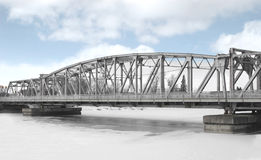 Girder bridge over a frozen river. Royalty Free Stock Photo