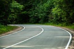 Gire a estrada do campo Foto de Stock