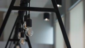 Gire lâmpadas fora penduradas no escritório Fotos de Stock Royalty Free