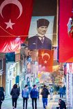 Giresun, Turkey - May 5, 2017. Crowdy Main Street at night with Turkish flag and poster of ex-president Ataturk. Giresun, Turkey - May 5, 2017. Crowdy Main royalty free stock photos