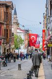 Giresun, Turkey - May 6, 2017. Crowdy Main Street with Turkish flag and minaret. And portrait of Ataturk stock photography