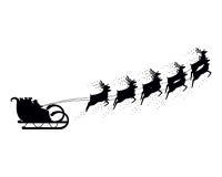 Giri di Santa Claus in una renna della slitta Immagini Stock Libere da Diritti