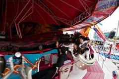 Giri ed attrazioni - Dragon Dance Fotografia Stock