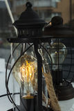 Giri la lampadina sopra principale, sulle lampade clasical immagini stock libere da diritti
