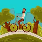 Giri urbani del ciclista dei pantaloni a vita bassa nella città Fotografia Stock