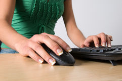 Girl's hand on mouse Stock Photos