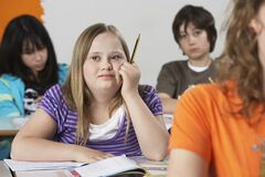 Free Girl (10-12) With Down Syndrome In Classroom Stock Photo - 191844820