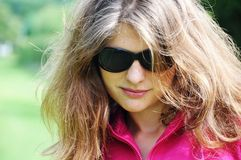 Girl. With black sunglasses in the park Stock Photography