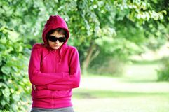 Girl. With black sunglasses in the park Royalty Free Stock Photography
