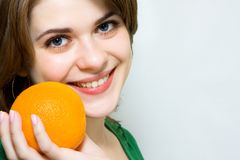 Girl. Smilling girl with  orange fruit Royalty Free Stock Photography