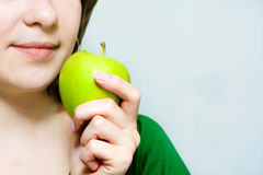 Girl. With a green apple Royalty Free Stock Images