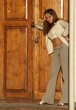 Girl. At the closed door in the house Royalty Free Stock Photo