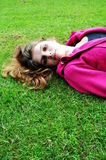 Girl. Lying in the park Royalty Free Stock Photography