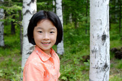 Girl. The little girl in the forest Royalty Free Stock Photography