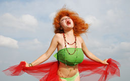 A girl. Yells on a background sky Royalty Free Stock Photo