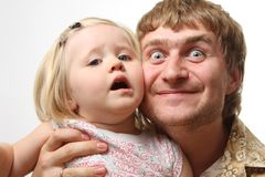 Girl. With  daddy on grey Royalty Free Stock Images