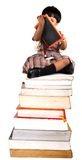 Girl. A girl sitting on the books with black board Stock Photos