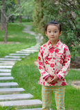 chinese little girl near the road stock image