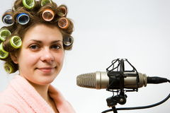 Girl. With old grey microphone Royalty Free Stock Photos