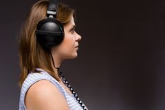 Girl. Beautiful girl with modern  headphones Royalty Free Stock Image
