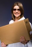 Girl. With big paper box Stock Photos