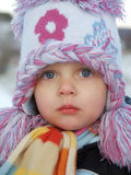 Girl. Baby with big cap during winter Stock Photo