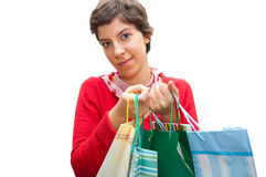 Girl. A young girl holds some shopping bags Stock Image