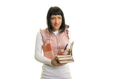 Girl. On a white background holding a pile of books Royalty Free Stock Photography