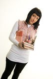 Girl. On a white background holding a pile of books Stock Image