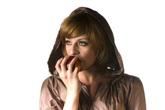 Girl. In a hood eating an apple Royalty Free Stock Images